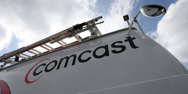 POMPANO BEACH, FL - FEBRUARY 13:  A Comcast truck is seen parked at one of their centers on February 13, 2014 in Pompano Beac