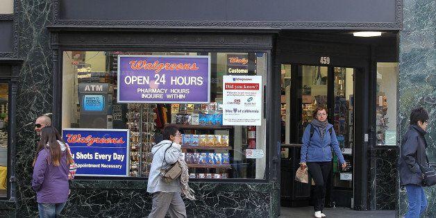 SAN FRANCISCO, CA - JUNE 19:  People walk by a Walgreens store on June 19, 2012 in San Francisco, California.  U.S. based dru