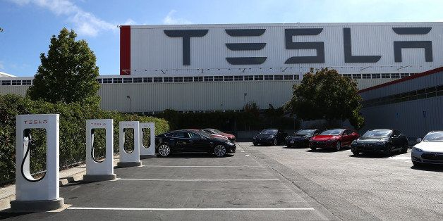FREMONT, CA - AUGUST 16:  A row of new Tesla Superchargers are seen outside of the Tesla Factory on August 16, 2013 in Fremon