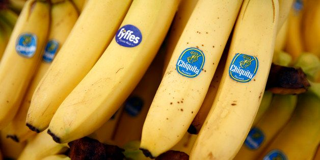 A bunch of Fyffes bananas, grown by Fyffes Plc, left, sits with bunches of Chiquita bananas, grown by Chiquita Brands Interna