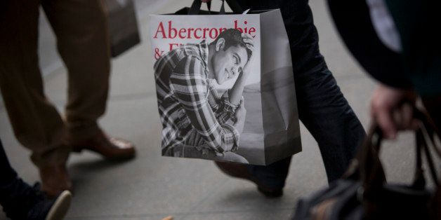 A customer carries an Abercrombie & Fitch Co. shopping bag from one of the company's locations in New York, U.S., on Wednesda