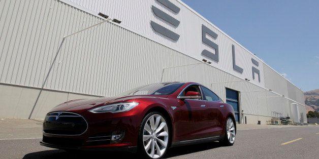 FILE - This June 22, 2012 file photo shows a Tesla Model S outside the Tesla factory in Fremont, Calif. Tesla Motors Inc. on