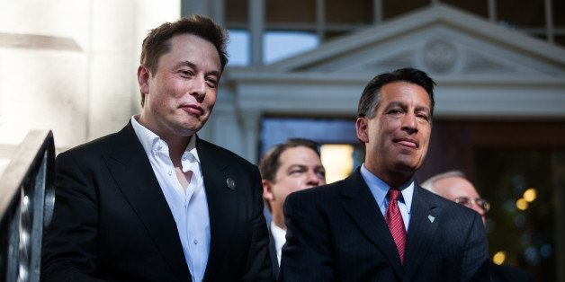 CARSON CITY, NEVADA- SEPTEMBER 4: Tesla Motors CEO Elon Musk, left, and Nevada Gov. Brian Sandoval, right, at a press confere