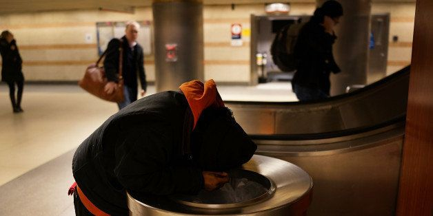 NEW YORK, NY - JANUARY 28:  A homeless man is viewed in Penn Station on January 28, 2014 in New York City. Over 3,000 volunte