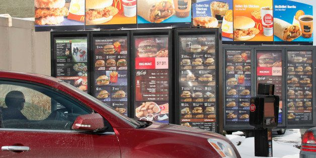 A patron looks at the menu at McDonald's in Williamsville, N.Y., Monday, Jan. 26, 2009. As most restaurant companies prepare