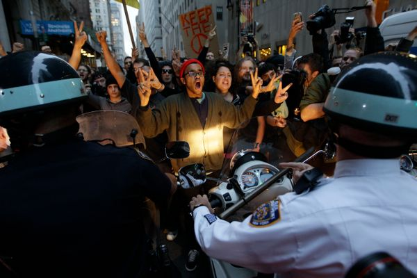 Demonstrators affiliated with the Occupy Wall Street protests confront New York City police officers as they march on the str