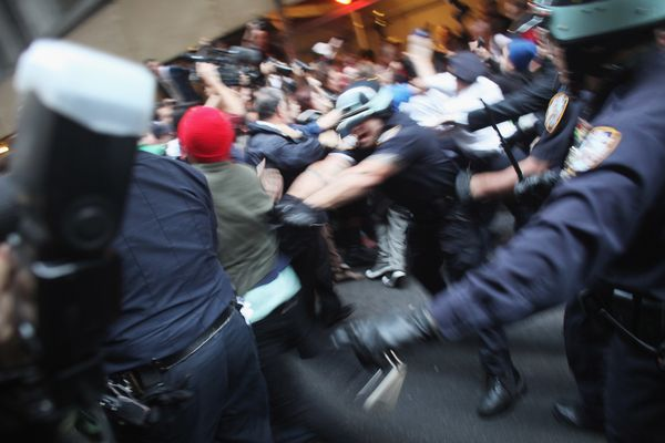 "Police scuffle with members of the ""Occupy Wall Street"" movement as they march through the streets of the financial district"