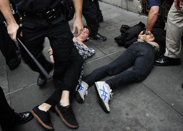 Members of Occupy Wall Street are arrested as they clash with police during a celebration march after learning that they can