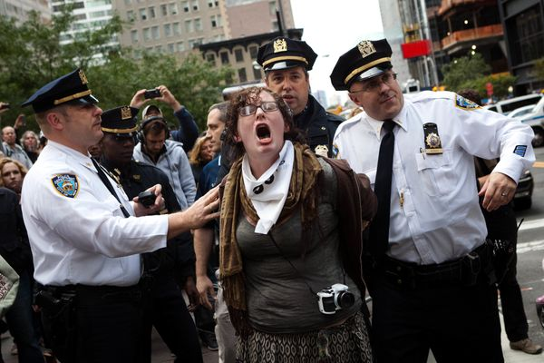 Occupy Wall Street protestor Alexi Morris is arrested along with at several others in the financial district's Zucotti park,