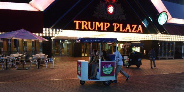 Three women are pushed down the boardwalk in a pushcart outside of Trump Plaza Casino September 15, 2014 in Atlantic City, Ne