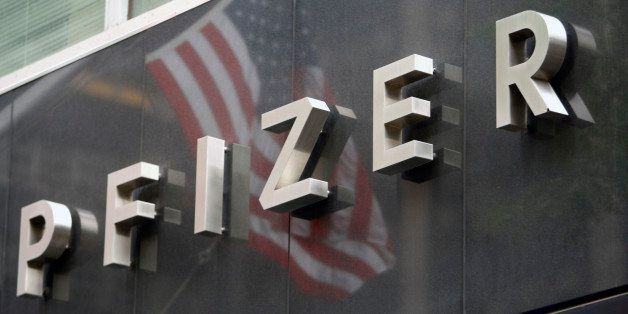 UNITED STATES - JUNE 18:  A U.S. flag is reflected in the Pfizer Inc. world headquarters in New York, U.S., on Wednesday, Jun