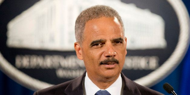 FILE - In this Sept. 4, 2014 file photo, Attorney General Eric Holder speaks during a news conference at the Justice Departme
