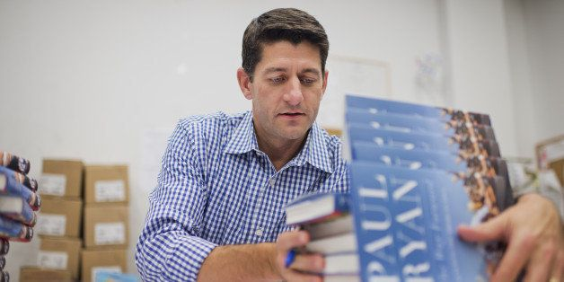 UNITED STATES - AUGUST 27: Rep. Paul Ryan, R-Wis., signs copies of his new book 'The Way Forward,' at the Barnes and Noble in