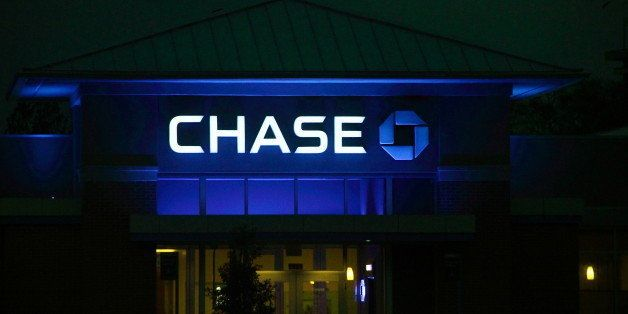 Glows blue at night... (Chase Bank upper facade bathed in blue light...)