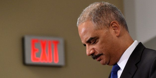 Outgoing Attorney General Eric Holder pauses while speaking at the Voting Rights Brain Trust event, Friday, Sept. 26, 2014, d