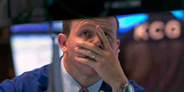 Specialist jason Notter works at his post on the floor of the New York Stock Exchange, near the close of trading, Friday, Oct. 10, 2014. U.S. stocks closed out a turbulent week with another loss, giving the market its worst week since May 2012. (AP Photo/Richard Drew)