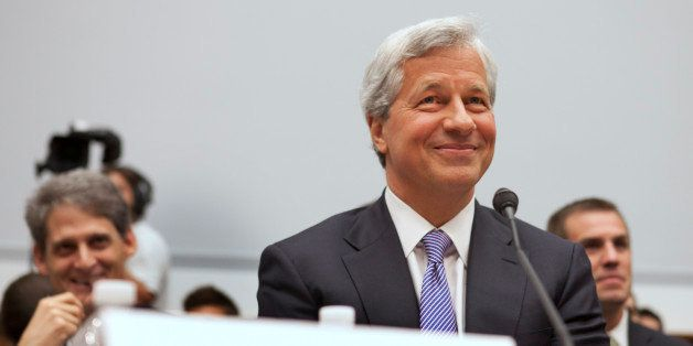 Jamie Dimon, CEO of JPMorgan Chase, smiles while testifying before the House Financial Services Committee on Capitol Hill in
