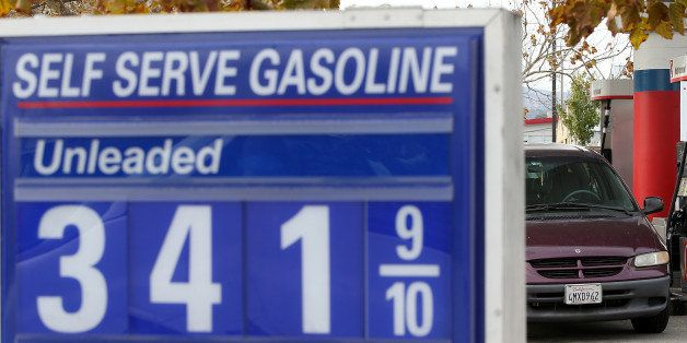 SAN RAFAEL, CA - OCTOBER 15:  Gas prices are displayed at a gas station on October 15, 2014 in San Francisco, California. Acc