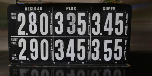 CORRECTS TRILLIONS TO BILLIONS - Gas prices below $3 dollars are displayed at a pump, Wednesday, Oct. 15, 2014, in Jersey Cit