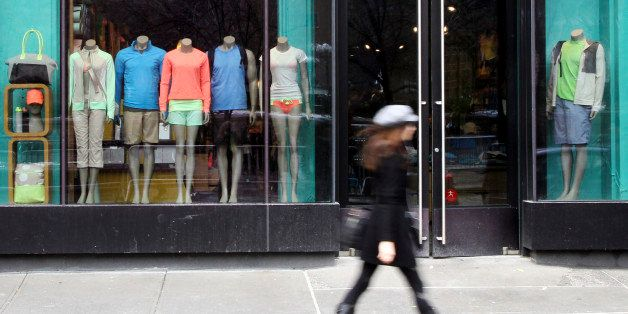 FILE - In this Tuesday, March 19, 2013, file photo, a woman walks past the Lululemon Athletica store at Union Square in New Y