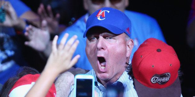 LOS ANGELES, CA - AUGUST 18:  New owner of the Los Angeles Clippers Steve Ballmer reacts to the fans after being introduced f