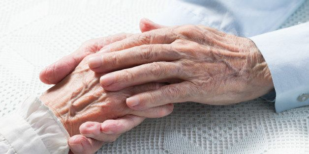 old people holding hands....