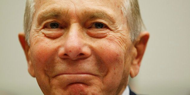 Former AIG head Hank Greenberg smiles on Capitol Hill in Washington, Thursday, April 2, 2009, prior to testifying before the