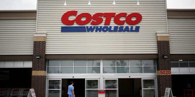 A man enters a Costco Wholesale Corp. store in Louisville, Kentucky, U.S., on Thursday, May 29, 2014. Costco Wholesale Corp.,