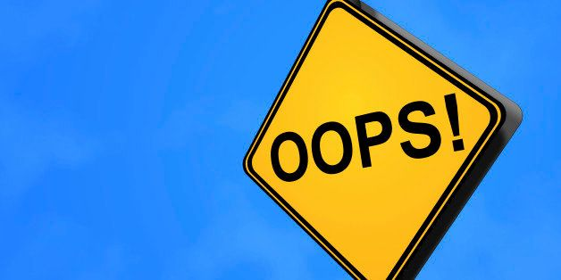 A yellow warning sign with the text 'OOPS!' against blue sky.