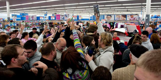 Shoppers vie for copies of video games at a Black Friday sale at a Wal-Mart Stores Inc. store in Mentor, Ohio, U.S., on Thurs