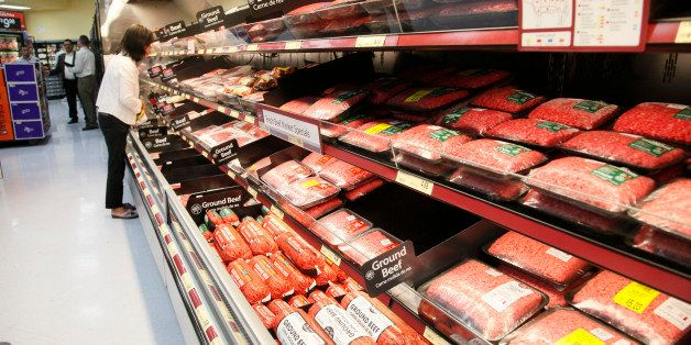 Consumers shop for meat products at the new Walmart Neighborhood Market, opening its 34,000 square foot store in the Chinatow