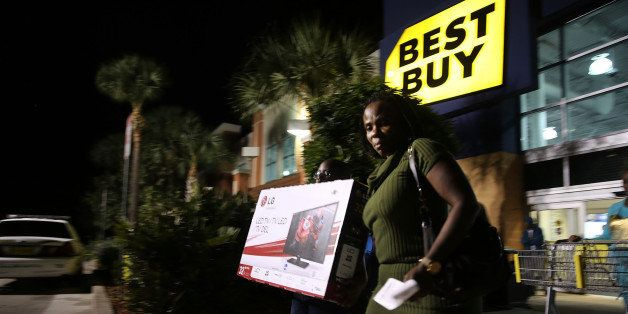NAPLES, FL - NOVEMBER 29: Black Friday shoppers carry away discounted items from a Best Buy store which opened its doors at 6
