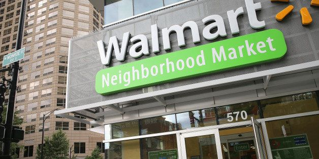 CHICAGO, IL - AUGUST 15:  Customers shop at a Walmart Neighborhood Market store on August 15, 2013 in Chicago, Illinois. Walm