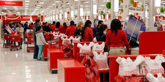 Customers purchase merchandise at a Target Corp. store opening ahead of Black Friday in Chicago, Illinois, U.S., on Thursday,