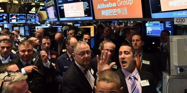 Traders wait for Chinese online retail giant Alibaba's stock to go live on the floor at the New York Stock Exchange in New Yo
