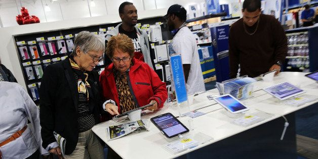 NAPLES, FL - NOVEMBER 29:  Black Friday shoppers looks for deals at a Best Buy store which opened its doors at 6pm on Thanksg