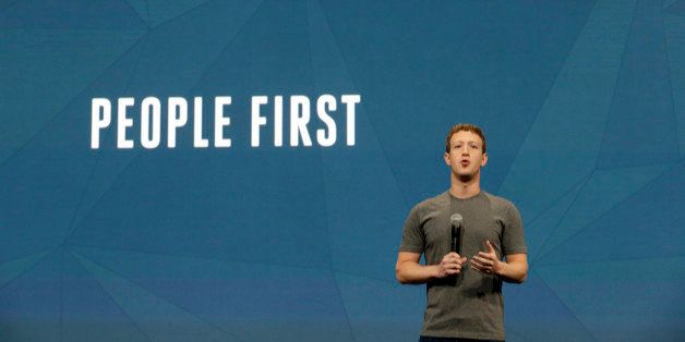 Facebook CEO Mark Zuckerberg gestures while delivering the keynote address at the f8 Facebook Developer Conference Wednesday,