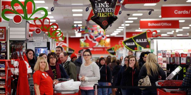 Target shoppers wait to check out on Black Friday, Nov. 28, 2014, in South Portland, Maine. The store opened at midnight. (AP