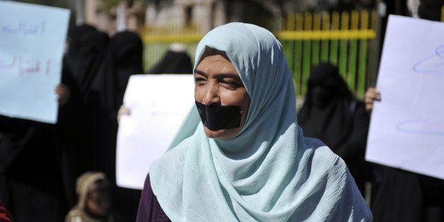 SANAA, YEMEN - NOVEMBER 22:  Yemeni woman with adhesive tape over her mouth attends a protest demanding the release of 5 deta
