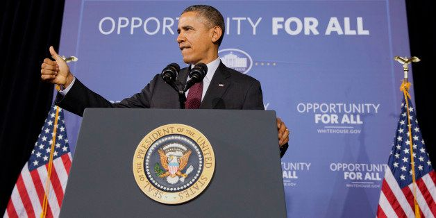 President Barack Obama makes the thumbs up sign as he ends a speech about his ConnetED goal of connecting 99% of students to