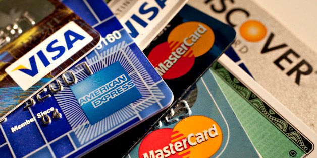 American Express, Discover, MasterCard and Visa credit cards are displayed for a photograph in New York, U.S., on Tuesday, Ma