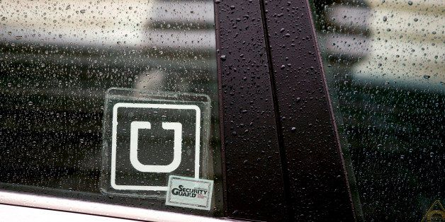 The Uber Technologies Inc. logo is displayed on the window of a vehicle after dropping off a passenger at Ronald Reagan Natio