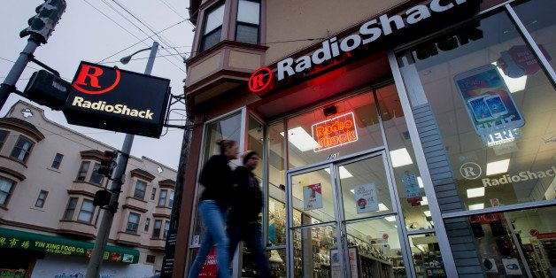 Pedestrians walk past a RadioShack Corp. store in San Francisco, California, U.S., on Saturday, June 7, 2014. RadioShack Corp