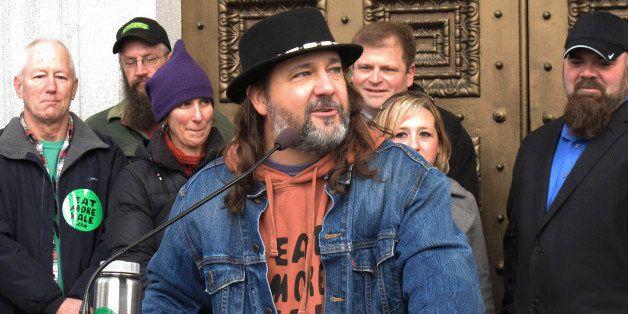 Vermont folk artist Bo Muller-Moore speaks Friday Dec. 12, 2014 outside the Vermont Statehouse in Montpelier about his winnin