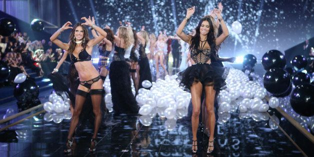 Alessandra Ambrosio, left, and Adriana Lima display creations with other models at the end of the Victoria's Secret fashion s