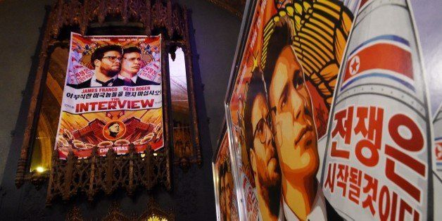 Movie posters for the premiere of the film 'The Interview' at The Theatre at Ace Hotel in Los Angeles, California on December
