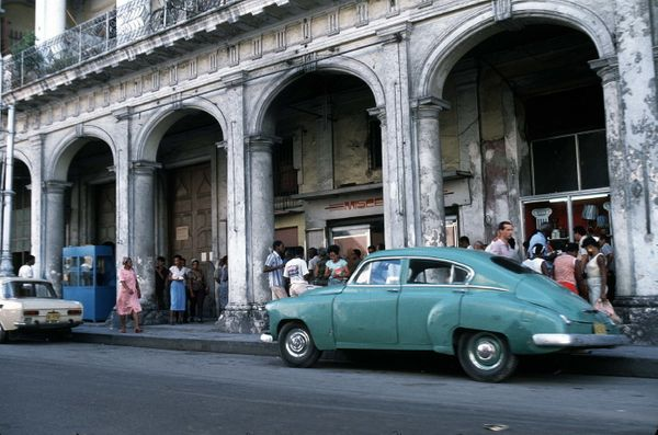 1980 - A 1950s model Chevrolet is parked on the street in Havana.