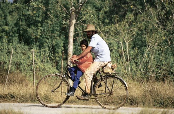 1994 - Two people on a bicycle in rural Cuba.