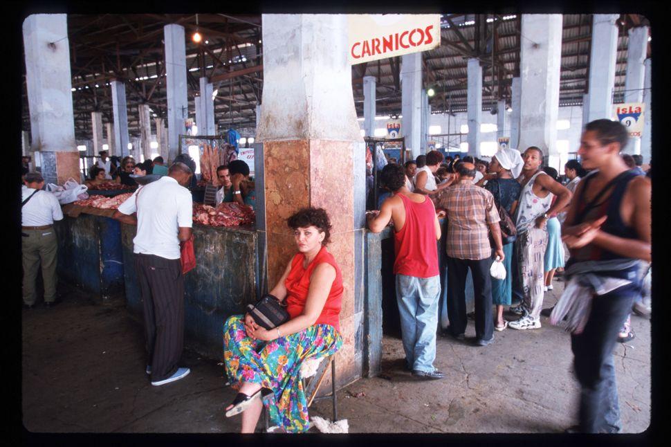 1999 - Cubans shop in one of Havana's main pesos food market Quatro Caminos in Havana. The Cuban economy was on the verge of