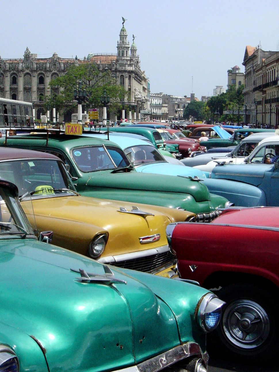 2003 - Several earlier model American-made cars wait to be rented in Havana. New car imports have been allowed in Cuba since